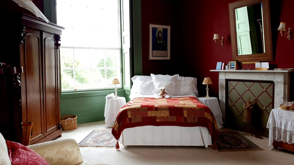 Burgundy Room at Penfro, double bed and large window overlooking the church